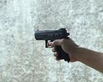 Thượng úy công an bắn người trong quán nhậu bằng súng tự mua