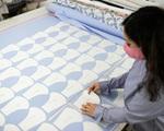 Forbes: Dệt may Việt Nam 'đánh bại' COVID-19 nhờ khẩu trang