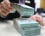 Lãi suất tiền gửi tiếp tục giảm tại một số ngân hàng - ảnh 1