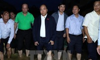 Prime Minister Nguyen Xuan Phuc visits flooded Hoi An