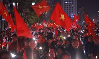 Vietnamese football fans flock to the streets to celebrate Vietnam's football team victory