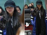 Thang Duy giấu bụng bầu khi xuất hiện tại sân bay