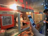 Quét mã QR - Trào lưu thanh toán không dùng tiền mặt ở Trung Quốc