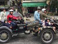 CNN crew explores Hanoi on a sidecar
