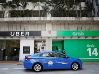 Thương vụ Grab mua Uber có dấu hiệu vi phạm pháp luật