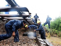 Land erosion affects North-South railway after storm Usagi