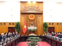 Deputy PM meets delegates to Vietnam-China People's Forum