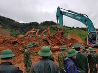 Rescue work at landslide site continues overnight, 18 bodies retrieved