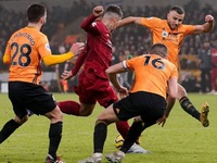 Liverpool move towards title with 2-1 win at Wolves