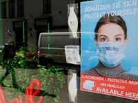 Áo bắt buộc người dân đeo khẩu trang tại siêu thị