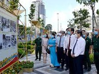Photo exhibition marks 75th anniversary of August Revolution and National Day