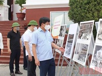 Photo exhibition highlights President Ho and NA and People's Councils elections