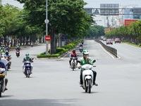 Hà Nội yêu cầu dừng hoạt động giao hàng bằng xe công nghệ
