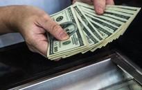 Đồng USD sụt giảm theo đà tăng của chứng khoán