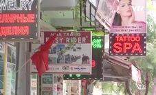 Biển hiệu sính ngoại tràn ngập phố Hà Nội