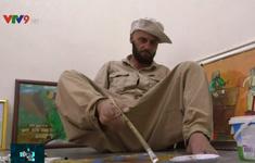 Họa sỹ Iraq vẽ tranh bằng chân