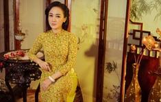 BTV Hoài Anh duyên dáng với áo dài truyền thống