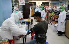 Số ca nhiễm mới COVID-19 trong ngày cao kỷ lục tại Indonesia