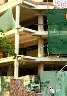 Hướng nào cho sổ đỏ tại dự án nợ tiền sử dụng đất?