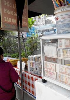 Nghiêm cấm đổi tiền lẻ hưởng phí chênh lệch
