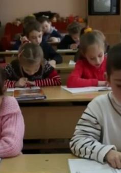 Thỏa thuận đình chiến của Ukraine giúp các em nhỏ yên tâm tới trường