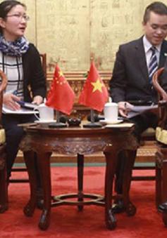 Chủ tịch QH Nguyễn Sinh Hùng gặp Chủ tịch Hội Hữu nghị đối ngoại nhân dân Trung Quốc