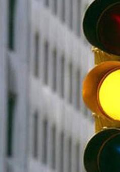 Ý kiến trái chiều về việc phạt vượt đèn vàng như vượt đèn đỏ