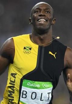 Usain Bolt đi vào lịch sử với HCV 100m thứ ba liên tiếp