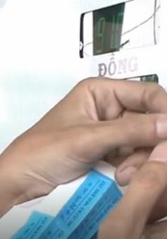 Đà Nẵng bắt đầu dán tem tại cây xăng