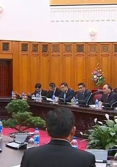 Thủ tướng tiếp Phó Thủ tướng, Bộ trưởng Bộ Tài chính Lào