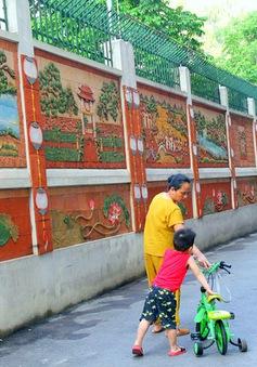 Người dân biến tường rác thành tranh nghệ thuật