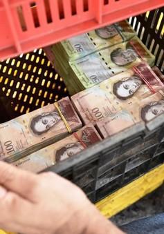 Muốn mua sắm nhanh ở Venezuela hãy... cân tiền, đừng đếm!