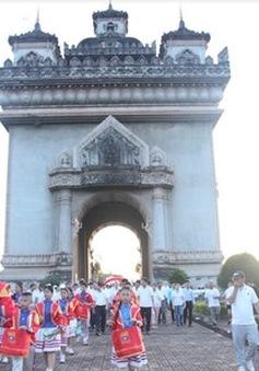 Đi bộ kỷ niệm 50 năm ngày thành lập ASEAN tại Lào