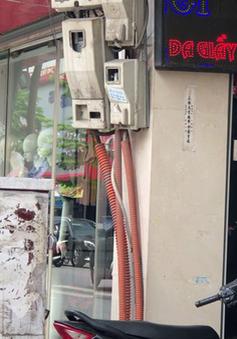 Mặt phố Hà Nội: Lộn xộn công tơ điện