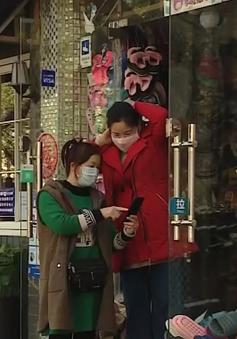 Hạ mức báo động y tế công cộng, doanh nghiệp Trung Quốc vui mừng