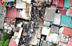 Khung cảnh hoang tàn nhìn từ trên cao sau vụ cháy lớn trên phố Đê La Thành
