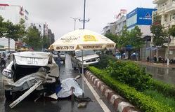 Nhân viên rửa xe lùi xe tông chết người, đâm xe biển xanh