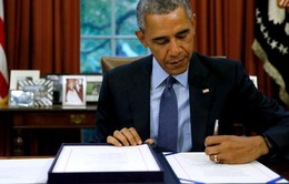 Tổng thống Obama ký luật ngân sách mới, nước Mỹ 'thở phào'