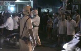 Hơn 200 cảnh sát dầm mưa bao vây nhà trùm ma túy ở TP.HCM