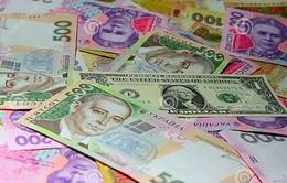 Đồng nội tệ Ukraine tiếp tục trượt giá mạnh