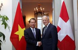 Phó Thủ tướng Vũ Văn Ninh hội đàm với Phó Tổng thống Thụy Sỹ