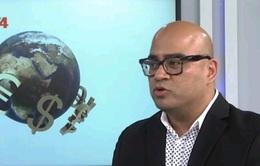 """""""Nền kinh tế Việt Nam sẽ có lợi khi VND giảm giá"""""""