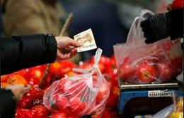 Trung Quốc hạ mức tăng trưởng năm 2015