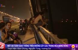 Hà Nội: Nguy cơ mất ATGT trên những cây cầu trong mùa nắng nóng