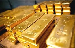 Vàng rời khỏi mức thấp trong 6 năm sau quyết định của FED