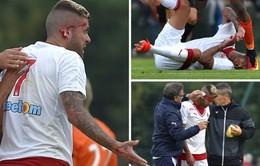 Cựu sao AC Milan đổ máu vì rách tai trong trận đấu ra mắt