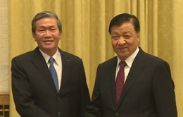 Đồng chí Đinh Thế Huynh hội đàm với Bí thư Ban Bí thư Trung ương Đảng Cộng sản Trung Quốc