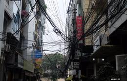 """Hà Nội dọn """"mạng nhện"""" trên 18 tuyến phố trong năm 2016"""
