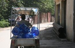 """Sản xuất nước đóng chai tinh khiết... siêu bẩn cho lãi """"siêu khủng"""""""