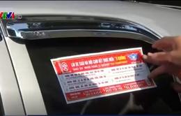 Hà Nội dán đề can cho gần 20.000 taxi để tuyên truyền luật